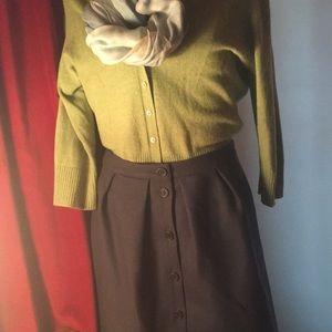 100% wool fully lined. Lovely feminine silhouette.